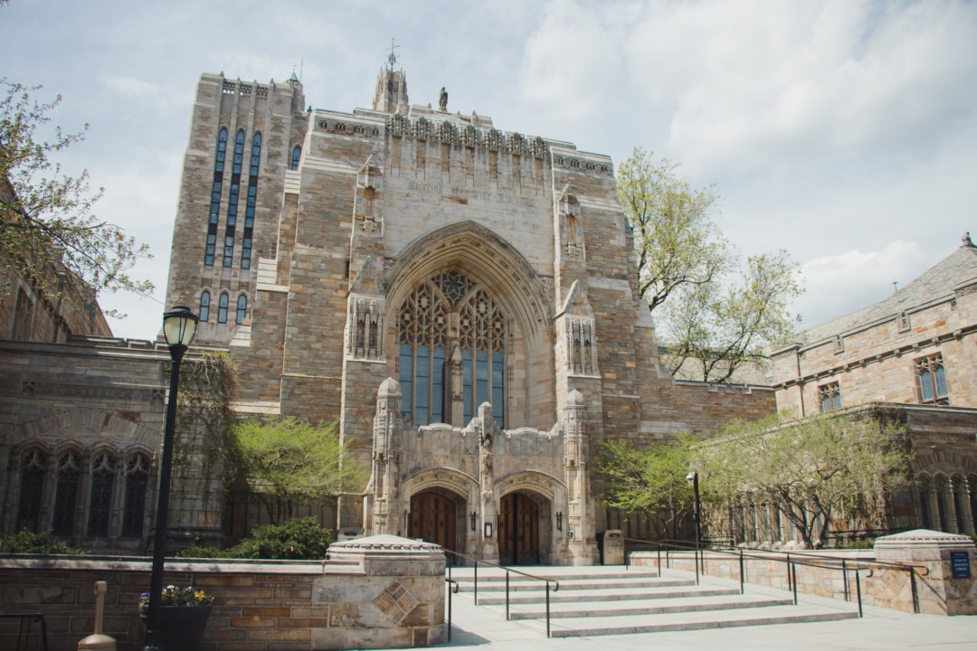Outside of Sterling Memorial Library at Yale University during the spring time