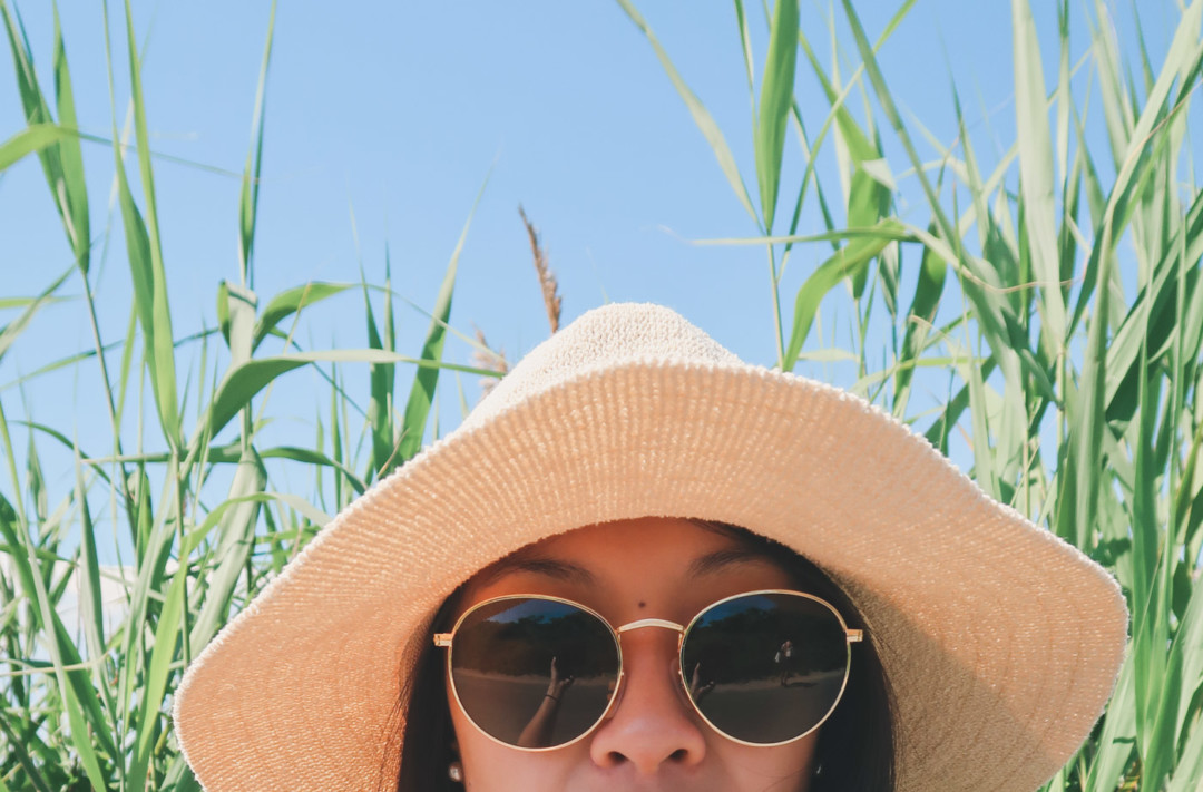 Sunglasses, sun hat at the beach
