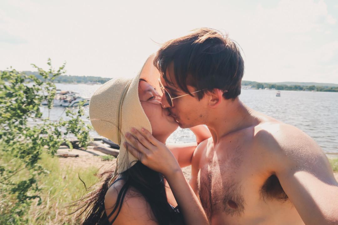 Kim and Dan kissing at the beach